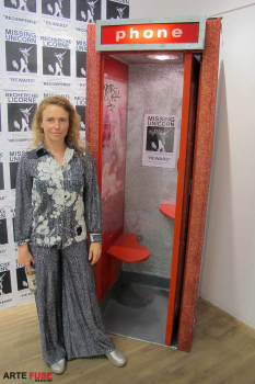 "Artist Camomile Hixon next to her work ""Phone Booth"""