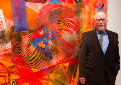 Artist Frank Owen at his opening