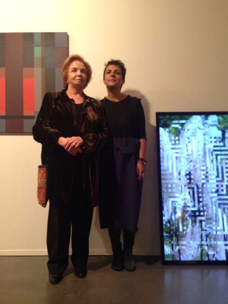 Fanny Sanin and Monika Bravo in front of their works