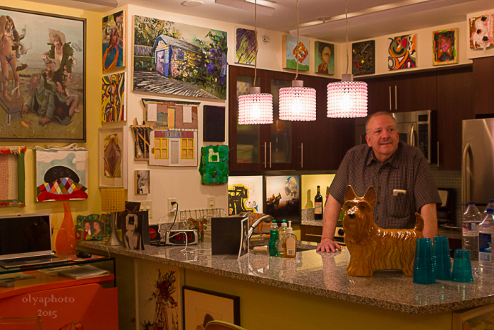 Steve Shane surrounded by a lot of Art