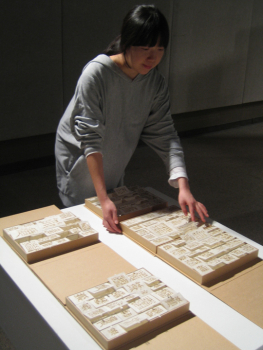 Sun Young Kang installing her book The Way to Be Empty, 2