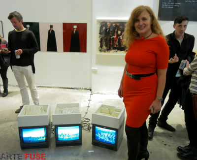 Artist Maria Aiolova next to her work