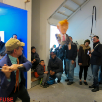 Curator and Director of Whitebox taking a shot at the Donald Trump Piñata.