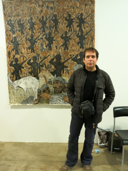 Artist Johan Wahlstrom in front of his work.