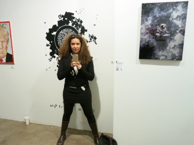 Artist Erin Ko with her work.