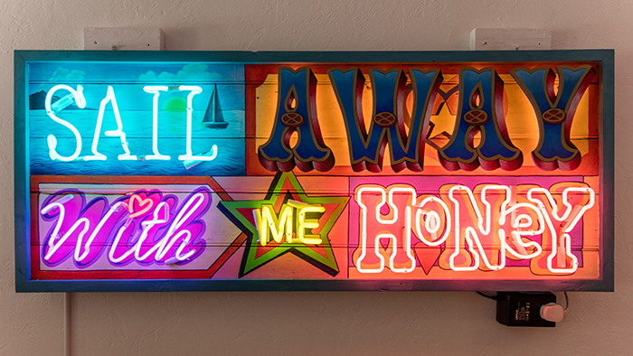 Chris Bracey, Sail Away, neon and carnival lights fitted to hand painted wood, Courtesy Old School Cornell Museum