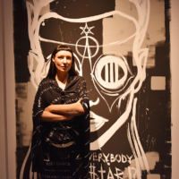 Artist Vera Kochubey in front of her work.