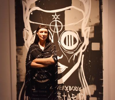 Artist Vera Kochubey in front of her work.
