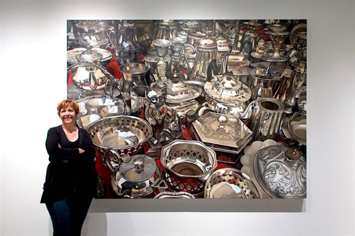 Margaret Morrison next to her painting Atomic No 47