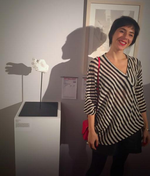 Artist Esmeralda Kosmatopoulos next to her sculpture.