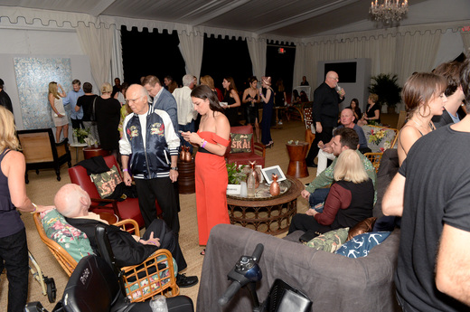 A view of the crowd at the Art Basel Fundraiser In Miami Beach With Sean Kelly And Paddle8 hosted by Absolut Elyx And Water For People at Nautilus Hotel on December 1, 2016 in Miami Beach, Florida. (Photo by Gustavo Caballero/Getty Images for Absolut Elyx)