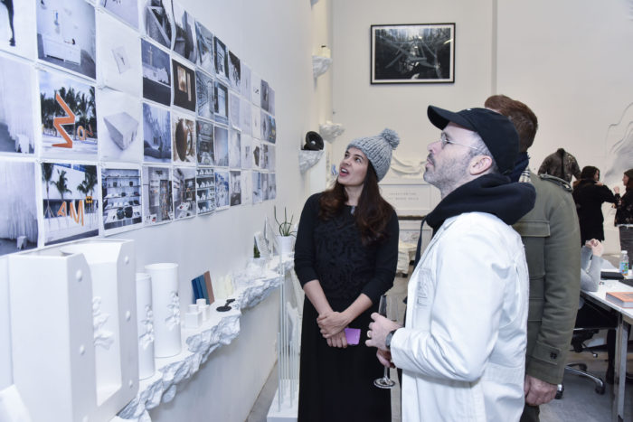 Daniel Arsham showing his architectural renderings to the guests